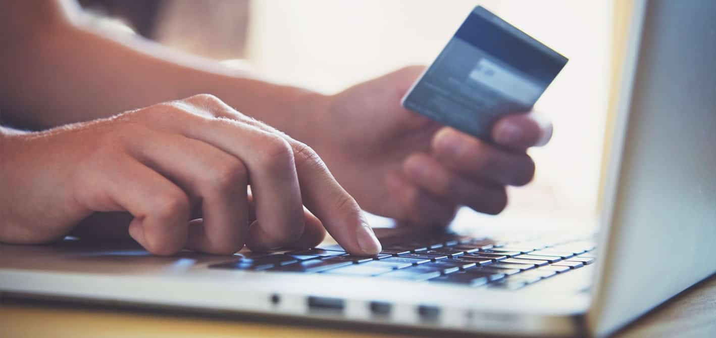 an image of an online shopper with credit card in hand